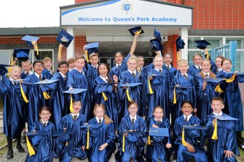 A class of Queens Park Academy pupils celebrate their year 6 graduation before departing for high school.