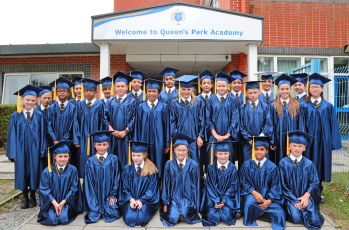 A Queens Park Academy class celebrate their year 6 graduation before departing for high school.