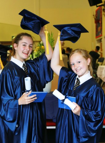 Queens Park Academy pupils celebrate their year 6 graduation before departing for high school. Kyra Farnum and Millie Jackson.