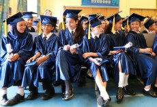 Queens Park Academy pupils celebrate their year 6 graduation before departing for high school.